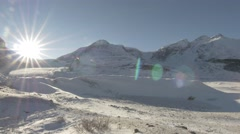 4k Snow Covered Mountains & Glacier Jasper Cold Icefield Sunlight Lens Flare Stock Footage