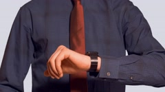 business man in dress shirt and tie raises smart watch and interacts - stock footage