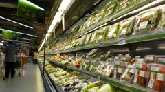 Stock Video Footage of fresh fruits and vegetables refrigerator in supermarket