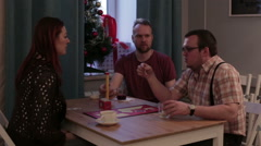 People play a board game sitting at the table Stock Footage