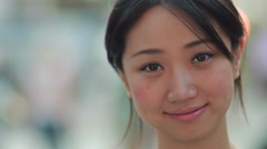 Young Asian woman smiling happy face portrait - stock footage