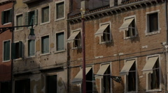 Old brick building with window blinds in Venice Stock Footage