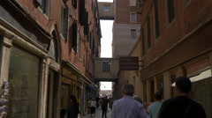 Tourists walking on Calle de le Rasse in Venice Stock Footage