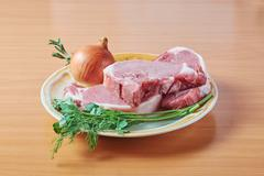 Ingredients for preparation of a lunch on a dish Stock Photos