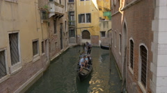 Two gondolas moving in a canal in Venice Stock Footage