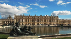 bronze statue and pool in the grounds of the palace of versailles - stock footage