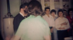 1959: Women joins family picture of solemn angry clan. BUFFALO, NEW YORK - stock footage