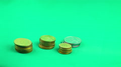 Coins are growing on a Green Background. TimeLapse - stock footage