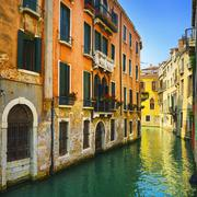 Venice sunset in water canal and traditional buildings. Italy Stock Photos
