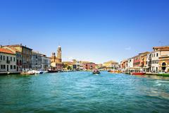 Murano glass making island, water canal and buildings. Venice, Italy, Europe. - stock photo