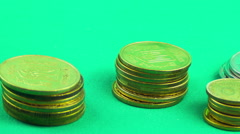 Coins are growing on a Green Background. TimeLapse Stock Footage