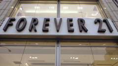 Forever 21 clothing store sign tilting down to front entrance Union Square NYC Stock Footage