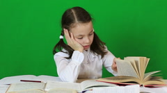 Sad girl writing, reeding. Child doing homework - stock footage