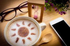 latte art coffee with sun design - stock photo