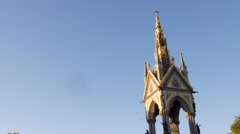 Tilt down the Albert Memorial in Hyde Park with Royal Albert Hall Stock Footage