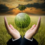 Time to save the environment concept, Businessman hold the green earth - stock photo