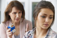 Mother Confronting Daughter Over Dangers Of Smoking Stock Photos