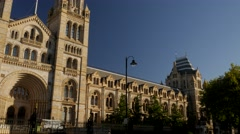Pan and tilt across the front of the Natural History Museum Stock Footage