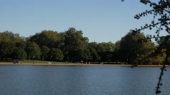 Pan across the Serpentine in Hyde Park London - stock footage