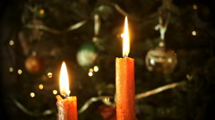 Candles in front of the Christmas tree  - stock footage