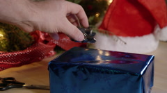Wrapping Christmas Gifts - December holiday Cinematic look Stock Footage