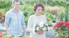 Young couple in the greenhouse Stock Footage