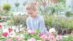 Little girl taking flower and inhaling the scent - stock footage
