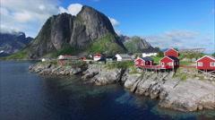 Flying above fishing village Hamnoya on Lofoten islands. Stock Footage