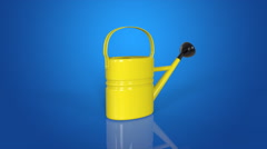 Watering can blue background Stock Footage