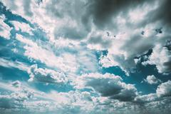 Cloudy Dramatic Sky, Bright Blue And White Colors - stock photo