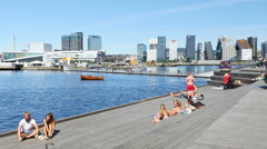 OSLO - NORWAY, AUGUST 2015: people sunbathing swimming opera house Stock Footage