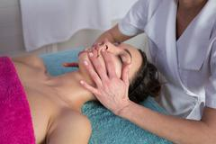 Face Massage. Young Woman Getting Spa Treatment. Stock Photos
