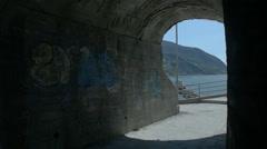 Graffiti in Coastal Tunnel Walkway near Beach - 25FPS PAL Stock Footage