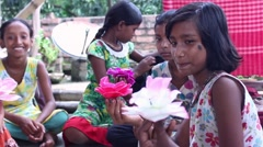 A group of girl students in India make paper flowers Stock Footage