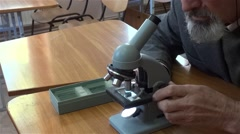Researcher studying microscopic preparation located on a glass slide 01 Stock Footage
