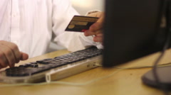 A man doing online transaction on the computer. - stock footage