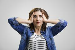 Astonished woman - stock photo
