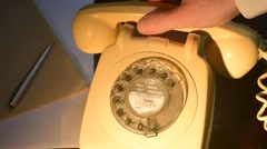 Person using old style rotary dial telephone Stock Footage