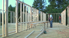 Stock Video Footage of Construction Workers Framing House
