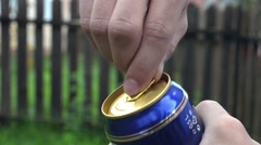 He pry the lid of a beer cans 1 Stock Footage