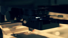 The equipment adjusts the position of the sample studied to better focus - stock footage