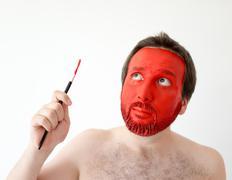 Painting man's face Stock Photos