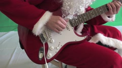 Santa Claus plays the guitar melody Christmas, New Year - stock footage