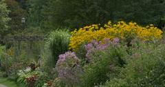 Couple walking in a beautiful flower garden at Niagara Falls, Canada Stock Footage