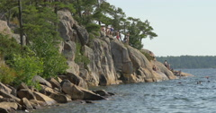 People standing on the rocks and swimming at Killbear Provincial Park Stock Footage