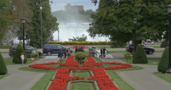 View of the waterfall and a flower bed in Queen Victoria Park at Niagara Falls Stock Footage