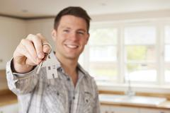 Man Moving Into New Home Holding House Shaped Keyring - stock photo
