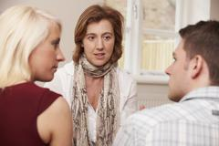 Couple Talking To Relationship Counsellor - stock photo