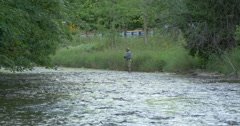 Man fishing in the river and car driving on the road at Caledon, Canada Stock Footage