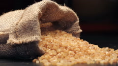 Brown sugar in gunny sack isolated on black, rotating Stock Footage